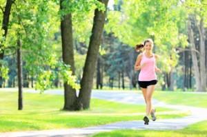 Jogging woman running in park
